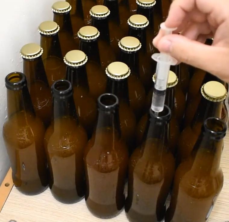 bottiglie priming siringa